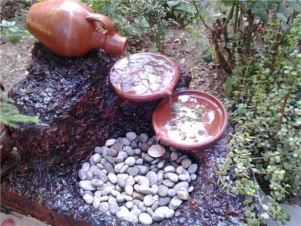 كيف تصنع نافورة في حديقة المنزل؟